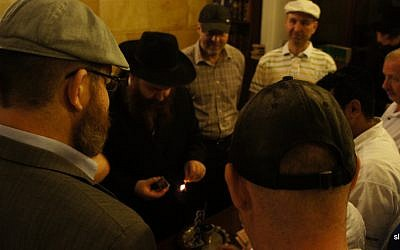 Jews participate in a Havdalah ceremony in a synagogue in Odessa, Ukraine, 2012. (photo credit: CC BY-Senia L/Flickr)