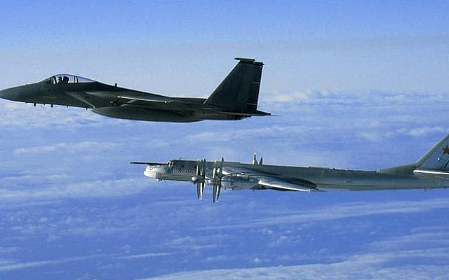 Illustrative photo of an American F-15 intercepting a Russian Tu-95 Bear Bomber during a Russian exercise near the west coast of Alaska in 2008. (US Air Force/Wikimedia Commons)