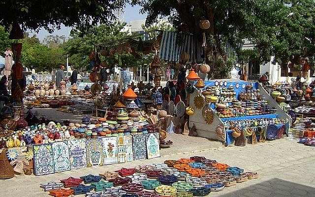 Illustrative photo of an outdoor market on the island of Djerba, Tunisia (photo credit: Chesdovi/Wikimedia Commons)