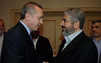 Hamas leader KHaled Mashaal, right, is greeted by Turkey's Prime Minister Recep Tayyip Erdogan in Ankara, Turkey, March 16, 2012 (photo credit: AP/Yasin Bulbul)