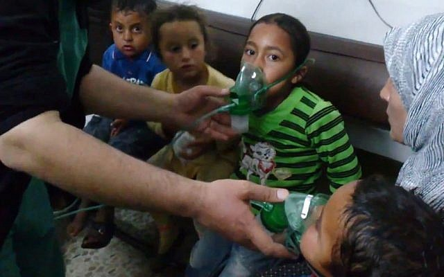 Illustrative photo: Children receive oxygen in Kfar Zeita, a rebel-held village in Hama province, Syria, after an alleged chemical attack, April 16, 2014. (AP Photo/Shaam News Network)