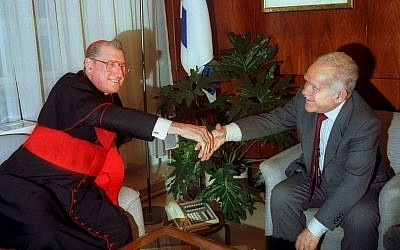 New York's Cardinal John J. O'Connor shakes hands with Israeli prime minister Yitzhak Shamir during a meeting in Jerusalem, Jan. 5, 1992. (photo credit: AP Photo)
