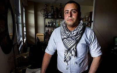 Tarab creator Bashar Makhay stands for a photo in his apartment in the Brooklyn borough of New York, on Sunday, May 4, 2014 (photo credit: AP/Craig Ruttle)