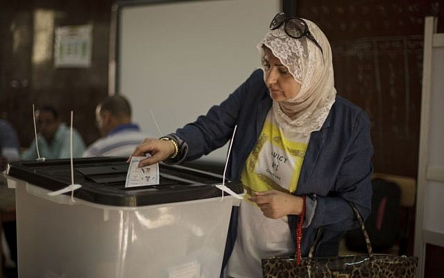 An Egyptian woman casts her vote at a polling site in the upscale Zamalek district of Cairo, Egypt, Tuesday, May 27, 2014, the second and final day of the presidential election with the country's former military chief Abdel-Fattah el-Sissi poised for an almost certain victory. (AP Photo/Maya Alleruzzo)