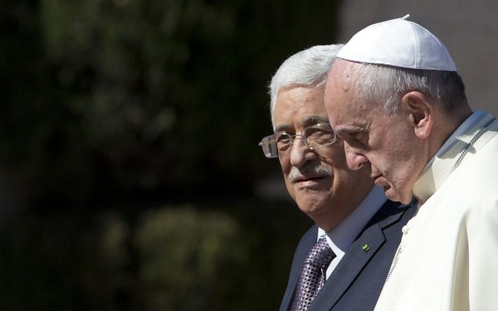 Pope Francis is welcomed by Palestinian Authority President Mahmoud Abbas upon his arrival to the West Bank city of Bethlehem, Sunday, May 25, 2014. (AP Photo/Andrew Medichini)