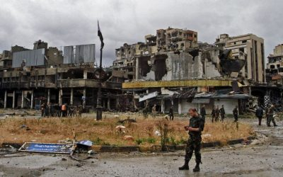 Syrian government forces inspect damage in Homs, Syria, Thursday, May 8, 2014. (photo credit: AP)