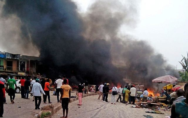 Smoke rises after a bomb blast at a bus terminal in Jos, Nigeria, on May 20, 2014. (photo credit: AP/Stefanos Foundation)