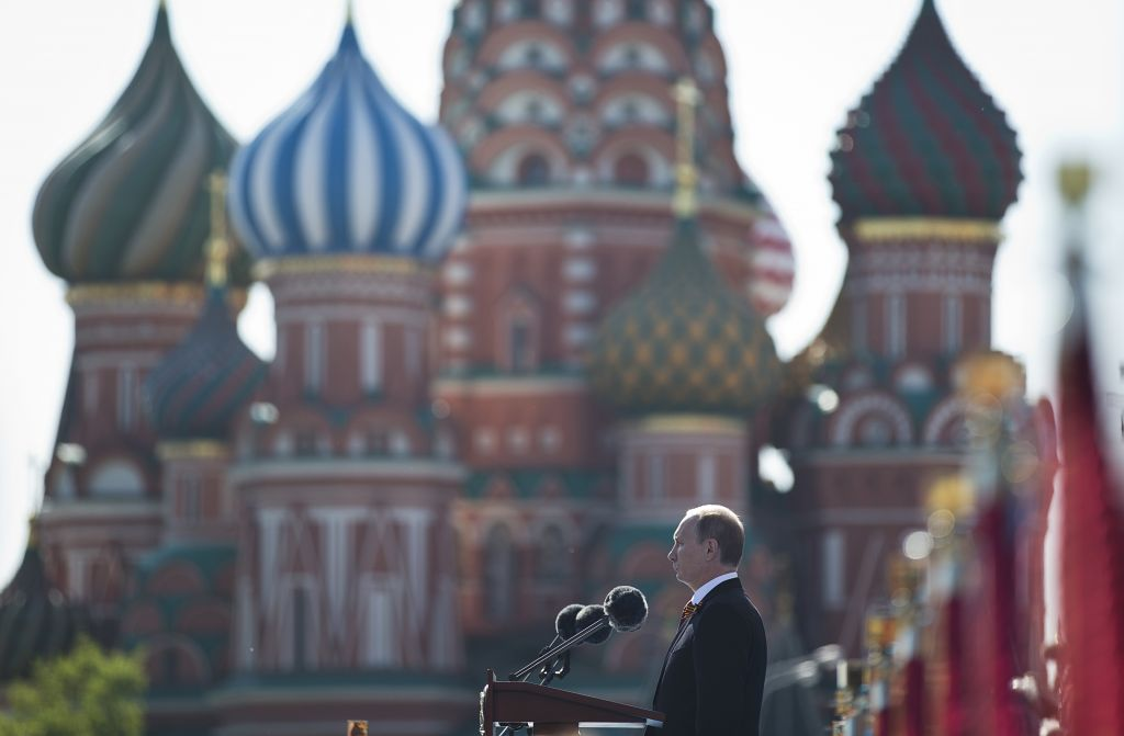 Vladimir Putin speaks during a Victory Day Parade in Red Square, with St. Basil Cathedral in the background, in Moscow, Russia, in May (photo credit: AP/Pavel Golovkin)