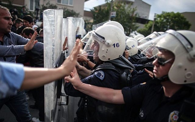 Riot police try to stop protesters attacking the offices of Prime Minister Recep Tayyip Erdogan's Justice and Development Party in Soma, Turkey, during the PM's visit on May 14, 2014. (photo credit: AP/Emrah Gurel)