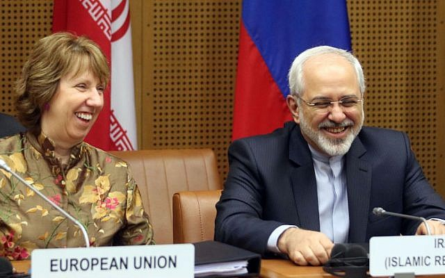 European Foreign Policy Chief Catherine Ashton (left), and Iranian Foreign Minister Mohammad Javad Zarif (right), before the closed-door nuclear talks in Vienna, Austria, on Wednesday, May 14, 2014. (photo credit: AP/Ronald Zak)