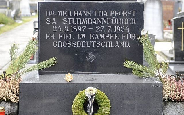 """A Tuesday, Jan. 21, 2014 file photo showing a marble tombstone which is adorned by a swastika and the inscription """"He died in the struggle for a Great Germany"""" at the central cemetery in Graz, Austria. (photo credit: AP/Hans Punz)"""