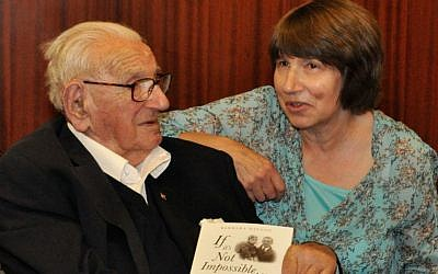 Sir Nicholas Winton with his daughter Barbara Winton. He holds her new biography of him titled, 'If It's Not Impossible.' (Courtesy of Barbara Winton)