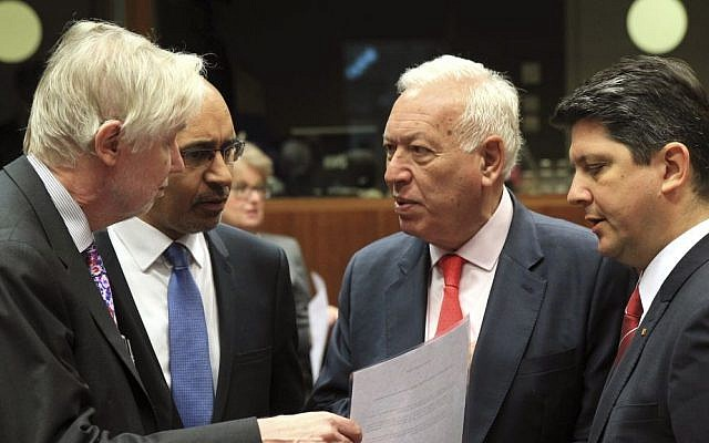 Spain's Foreign Minister Jose Manuel Garcia-Margallo y Marfil, second right, talks with Finland's Foreign Minister Erkki Sakari Tuomioja, left, French Secretary of State for European Affairs Harlem Desir, second left, and Romania's Foreign Minister Titus Corlatean during an EU foreign ministers meeting at the European Council building in Brussels Monday, May 12, 2014. (photo credit: AP/Yves Logghe)