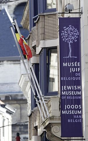 A banner shows the facade of the Jewish museum, the site of a shooting in Brussels, Saturday, May 24, 2014 (photo credit: AP/Yves Logghe)