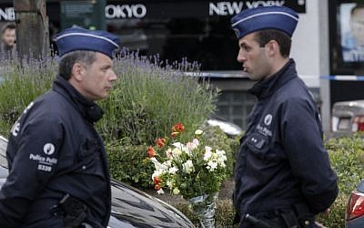 Belgian police at the site of a shooting at the Jewish Museum in Brussels, on Saturday, May 24, 2014. (photo credit: AP Photo/Yves Logghe)