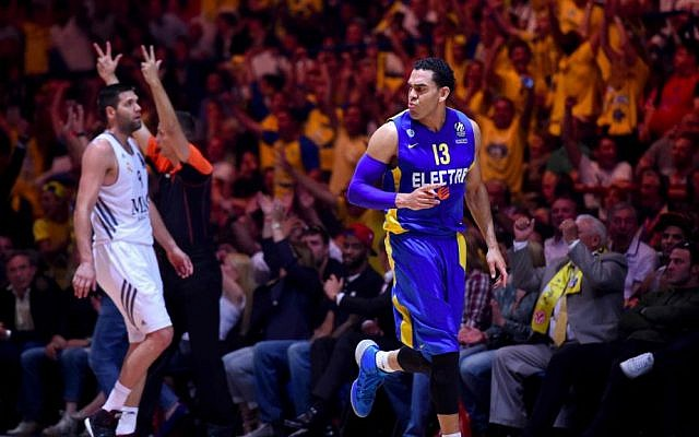 David Blu, right, shooting a three-pointer during a championship game for Maccabi Tel Aviv (photo credit: Noam Galai)