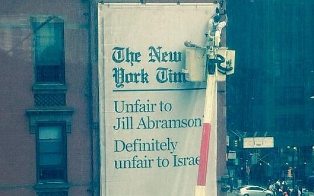 A sign plastered outside the New York Times' Times Square offices, accusing it of 'unfair' treatment of both former executive editor Jill Abramson -- and Israel. (photo credit: Twitter)