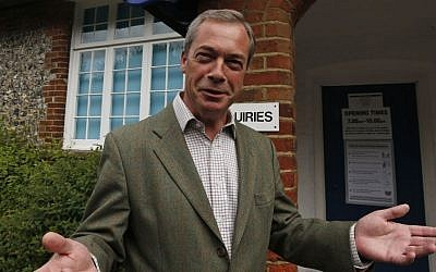 Nigel Farage, leader of Britain's United Kingdom Independence Party (UKIP) poses for the media before voting for the European Parliament in Cudham, England, on Thursday, May 22, 2014. (photo credit: AP/Lefteris Pitarakis)