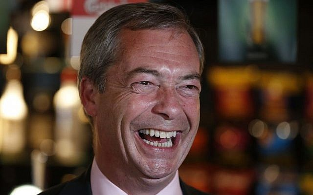 Nigel Farage, leader of Britain's United Kingdom Independence Party (UKIP), smiles at a pub in South Benfleet, England. (photo credit: AP/Lefteris Pitarakis)