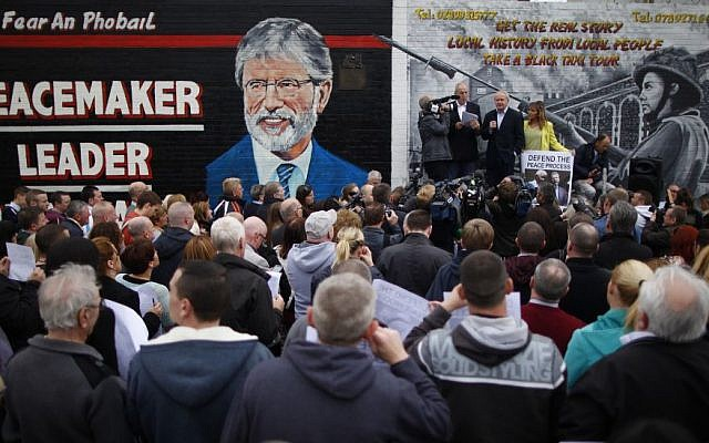 Sinn Fein's Martin McGuinness, center, with party members Bobby Storey, left, and Martina Anderson speak during a protest rally on the Falls Road, West Belfast, Northern Ireland, Saturday, May, 3, 2014 (photo credit: AP/Peter Morrison)