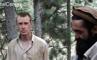 This file image provided by IntelCenter on Dec. 8, 2010, shows a frame grab from a video released by the Taliban containing footage of a man believed to be Bowe Bergdahl, left. (photo credit: AP/IntelCenter, File)