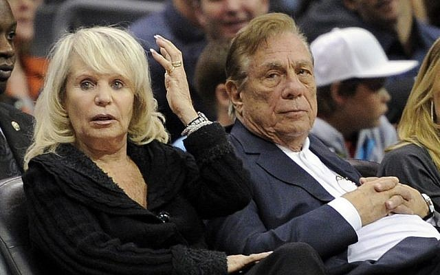 Los Angeles Clippers former owner Donald Sterling sits with his wife, Shelly, during the Clippers NBA basketball game against the Detroit Pistons in Los Angeles, in November 2010 (photo credit: AP/Mark J. Terrill, file)