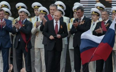 Vladimir Putin, center, is greeted by spectators (unseen) after speaking at a gala concert marking Victory Day in Sevastopol, Crimea, in May 2014. (photo credit: AP/Ivan Sekretarev)