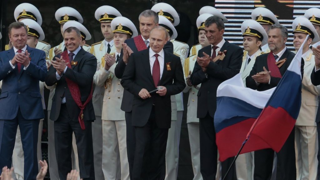 Vladimir Putin, center, is greeted by spectators (unseen) after speaking at a gala concert marking Victory Day in Sevastopol, Crimea, on Friday (photo credit: AP/Ivan Sekretarev)