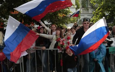 Residents wave Russian flags during a Victory Day military parade in Sevastopol, Crimea, Friday, May 9, 2014.  (Photot credit: AP/Ivan Sekretarev)