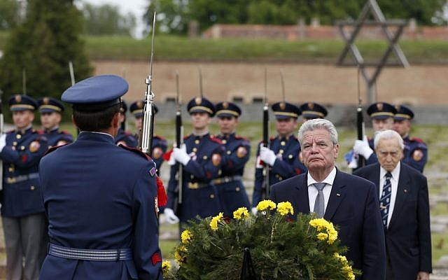 Germany's President Joachim Gauck lays a wreath of flowers at a memorial in former nazi concentration camp of Terezin in Terezin, Czech Republic, Tuesday, May 6, 2014. Gauck is to Czech Republic on a three-day official visit. (photo credit: AP/Petr David Josek)