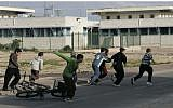 Illustrative: Israeli children run to a bomb shelter during a Color Red alarm warning of incoming rockets from the Gaza Strip, January 8, 2009. (Anna Kaplan/ Flash90/File)