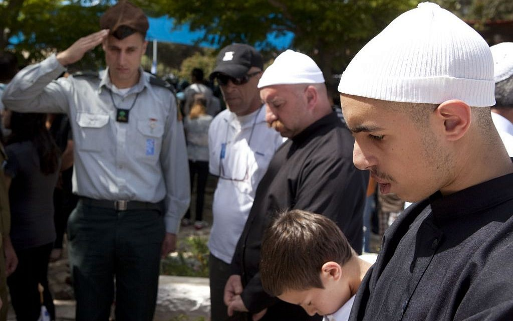 A Druze family stands silent during a Memorial Day ceremony at the military cemetery of Ussefiya on Mount Carmel, April 2010 (photo credit: Matanya Tausig/Flash90)