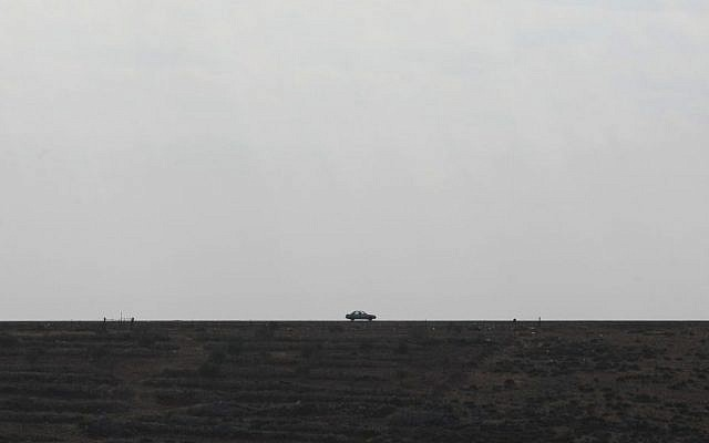 Illustrative photo of a car on a West Bank road, north of Jerusalem (Kobi Gideon/Flash90/File)