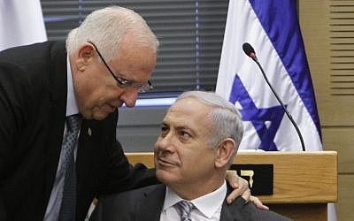 Prime Minister Benjamin Netanyahu (R) speaks with MK Reuven Rivlin at a party meeting in the Knesset on September 20, 2011. (photo credit: Miriam Alster/Flash90)