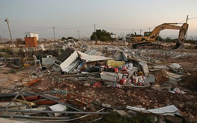 File: Destroyed buildings at the illegal outpost of Migron on September 12, 2012. (Oren Nahshon/Flash90)