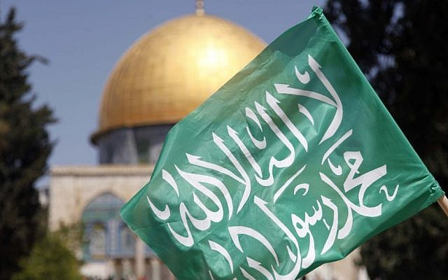 Illustrative: A Hamas flag at the Temple Mount, in 2013 (photo credit: Sliman Khader/Flash90)