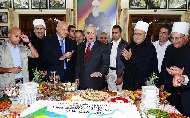 Israeli Prime Minister Benjamin Netanyahu meets with the Spiritual Leader of the Druze Community in Israel Sheikh Muwaffaq Tarif (2R) in the village of Julis in Northern Israel, April 25, 2013 (photo credit: Moshe Milner/GPO/FLASH90)
