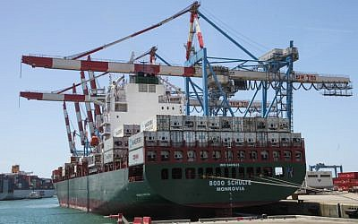 Cranes unload a cargo ship at the Ashdod port in July, 2013 (Isaac Harari/FLASH90)