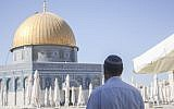 An Orthodox Jew stands facing the Dome of the Rock on the Temple Mount in the Old City of Jerusalem on July 24, 2013. (Lucie March/Flash90)