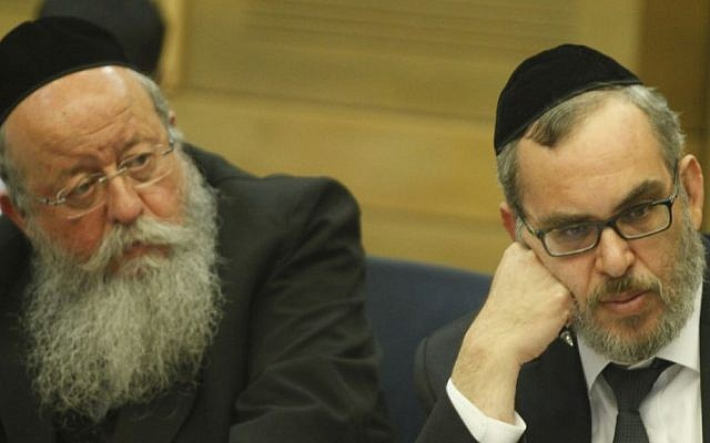 Ultra-Orthodox MKs Menachem Eliezer Moses (L) and Yaacov Asher attend a meeting regarding government actions to encourage ultra-Orthodox Jewish integration in the Israeli job market, August 2013. (photo credit: Flash90)