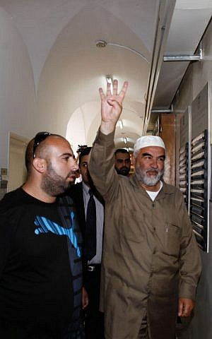 Sheikh Raed Salah, right, head of the Islamic Movement's northern branch, arrives at Jerusalem's Magistrates court after been arrested by Israeli police, on September 3, 2013. (photo credit: Flash90)