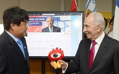 President Shimon Peres seen during a visit to the Weibo company headquarters in Beijing, China, where he launched his official Weibo page. Weibo is a Chinese microblogging website, similar to Twitter and Facebook. Peres was on an official 3-day visit to China, April 9, 2014. (photo credit: Amos Ben Gershom/GPO/Flash90)