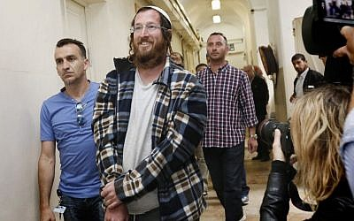 Elchana Finar, one of the Jewish settlers arrested for destroying an IDF outpost in the West Bank settlement of Yitzhar, following the demolition of illegal structures in the settlement, seen brought to Magistrates Court in Tel Aviv, on April 10, 2014. (Miriam Alster/Flash90)