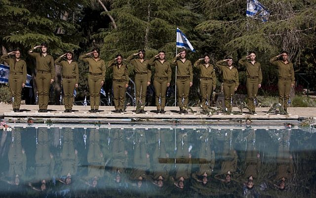 IDF soldiers standing at attention during a memorial ceremony in Israel. (photo credit: Flash90/Yonatan Sindel)