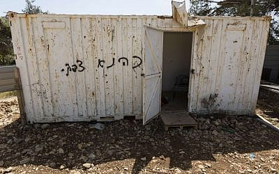 'Price tag' graffiti, saying 'Kahane was right,' sprayed onto a shed in a construction zone in Kiryat Ye'arim outside Jerusalem, on Sunday, May 4, 2014. (Photo credit: Flash 90)