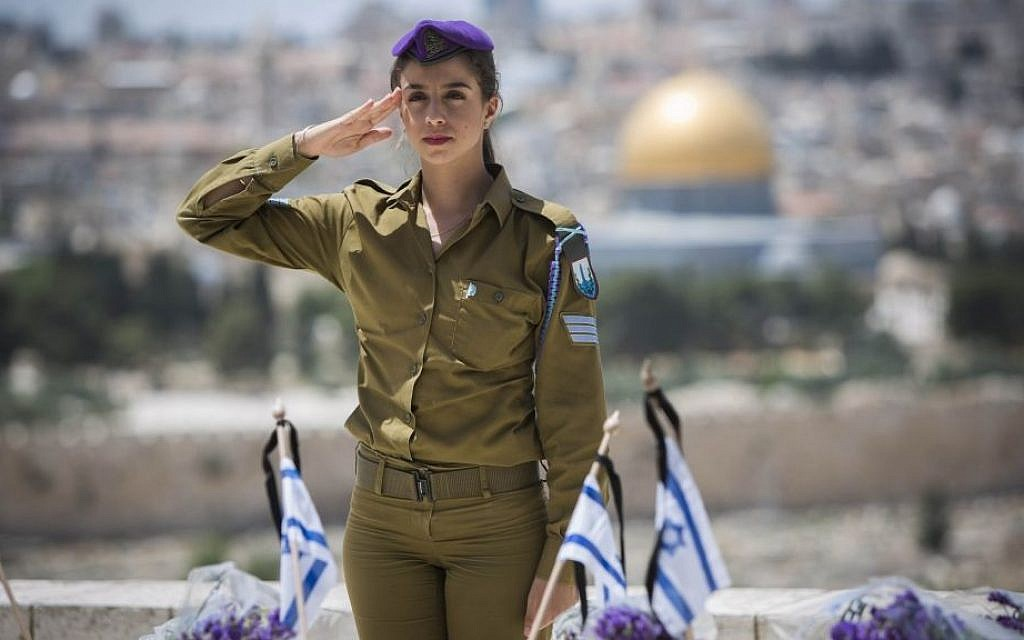 An Israeli soldier salutes fallen soldiers during a ceremony held on the Mount of Olives in preparation for Memorial Day, May 4, 2014. (photo credit: Yonatan Sindel/Flash90)