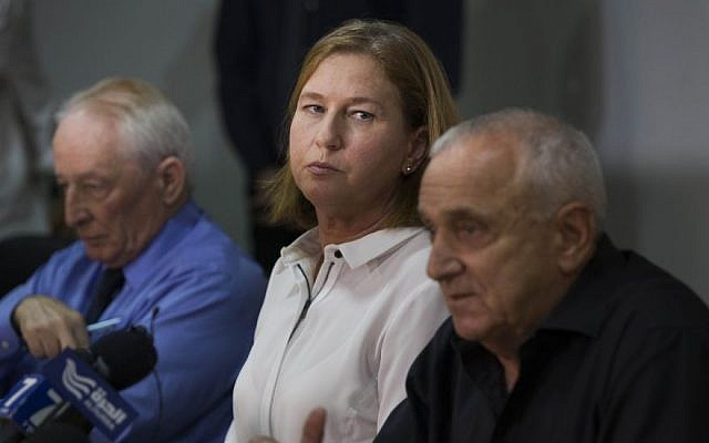 """Minister of Justice Tzipi Livni (C) seen with Internal Security Minister Yitzhak Aharonovich (R) and Attorney General of Israel Yehuda Weinstein at a press conference regarding emergency meeting about """"price tag"""" attacks at the Justice Ministry office in Jerusalem on May 7, 2014. (photo credit: Yonatan Sindel/Flash90)"""