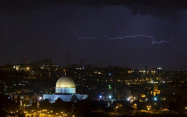 Lightning flashes over Jerusalem Wednesday night as a line of thunderstorms battered Israel (photo credit: Yonatan Sindel/Flash90)