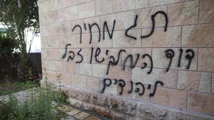 "Illustrative photo of anti-Christian graffiti reading ""Price tag, David the king, Jesus Junk for the Jews"" spray painted on the Romanian Church in Jerusalem on May 9, 2014 (Photo credit: Yonatan Sindel/Flash90)"
