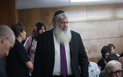 Eli Simhayoff arrives to the District Court in Tel Aviv to receive his sentence in the Holyland trial May 13, 2014. (Photo credit: Yotam Ronen/POOL/Flash90)